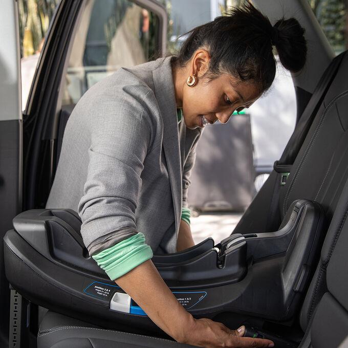 Woman installing car seat base