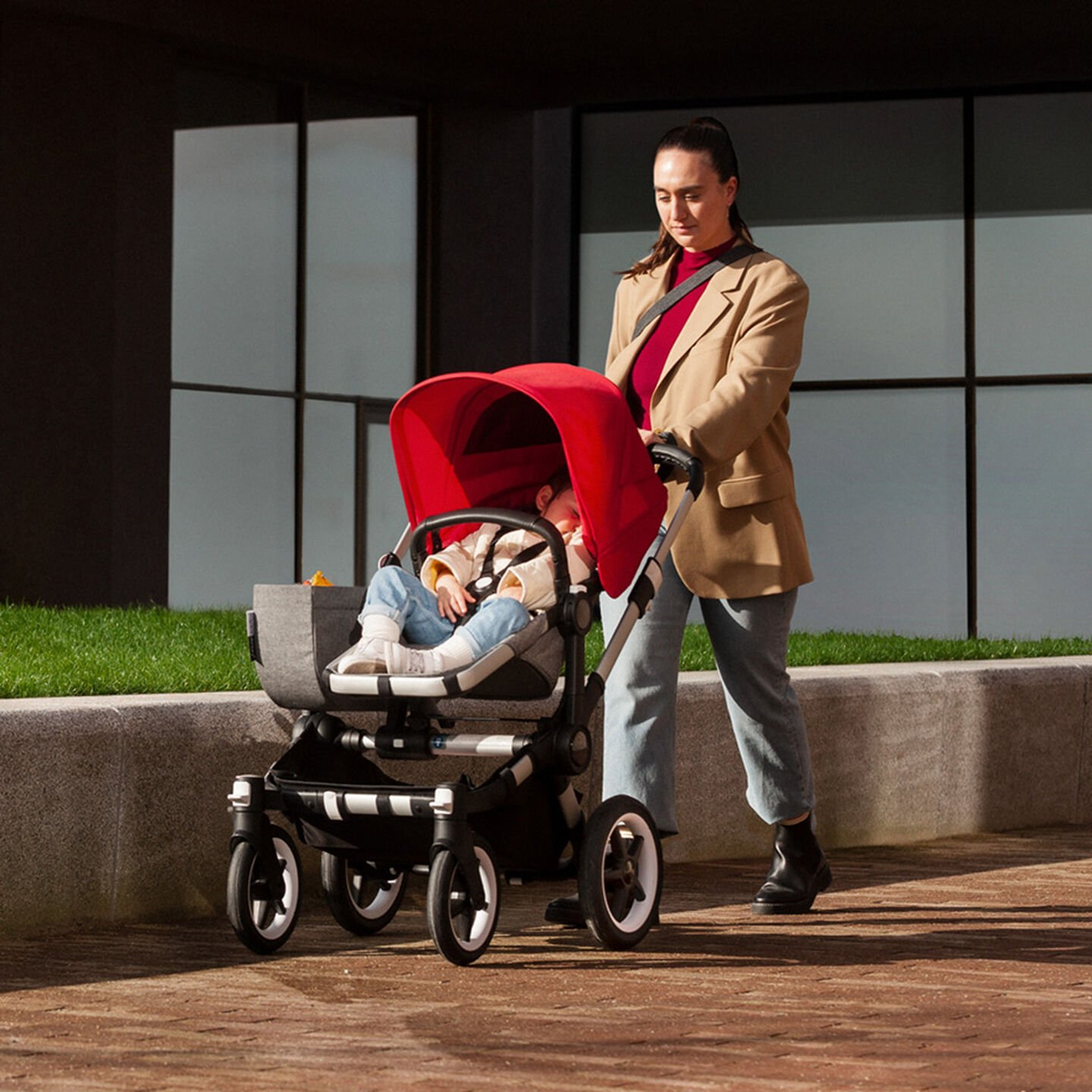 Woman walking with child in stroller