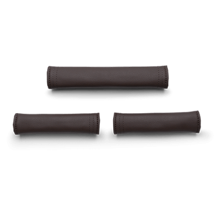 2 handlebar grips and 1 carry handle grip