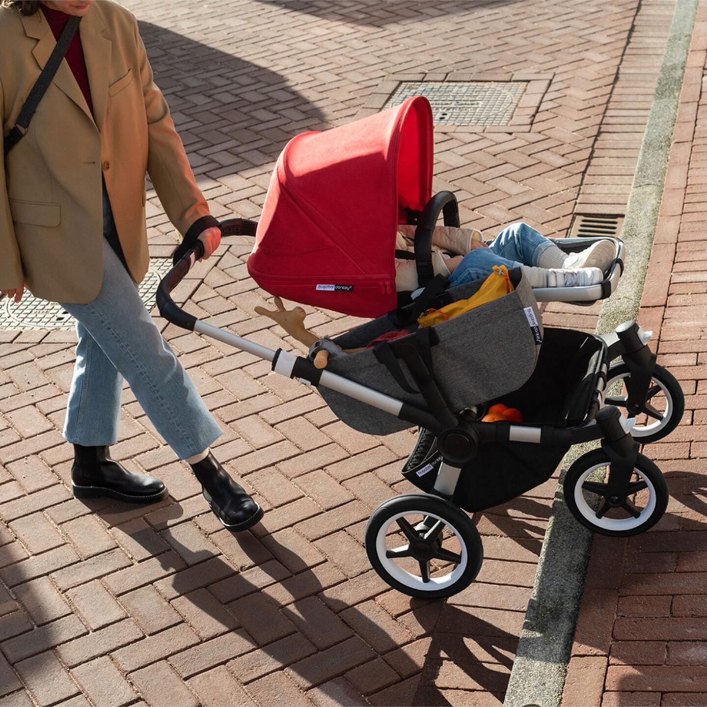 Stroller going up a sidewalk