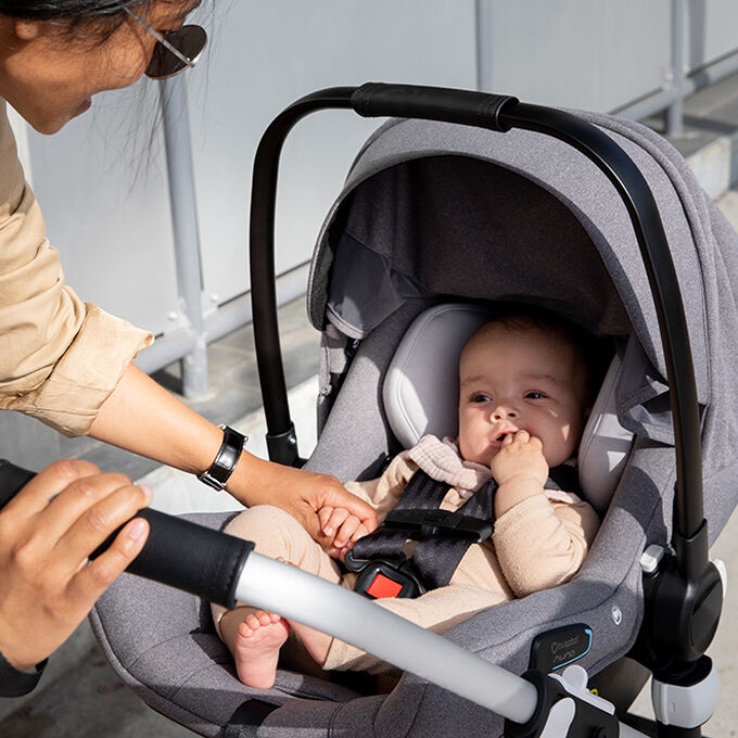 Baby in Turtle Air by Nuna car seat
