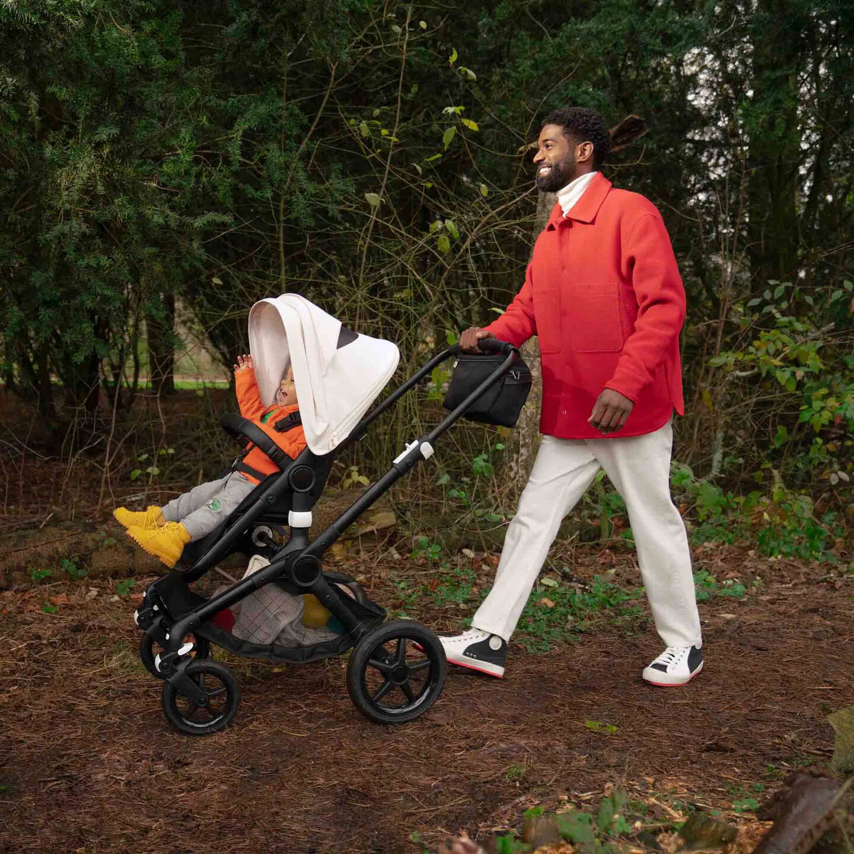Man pushing stroller on trail