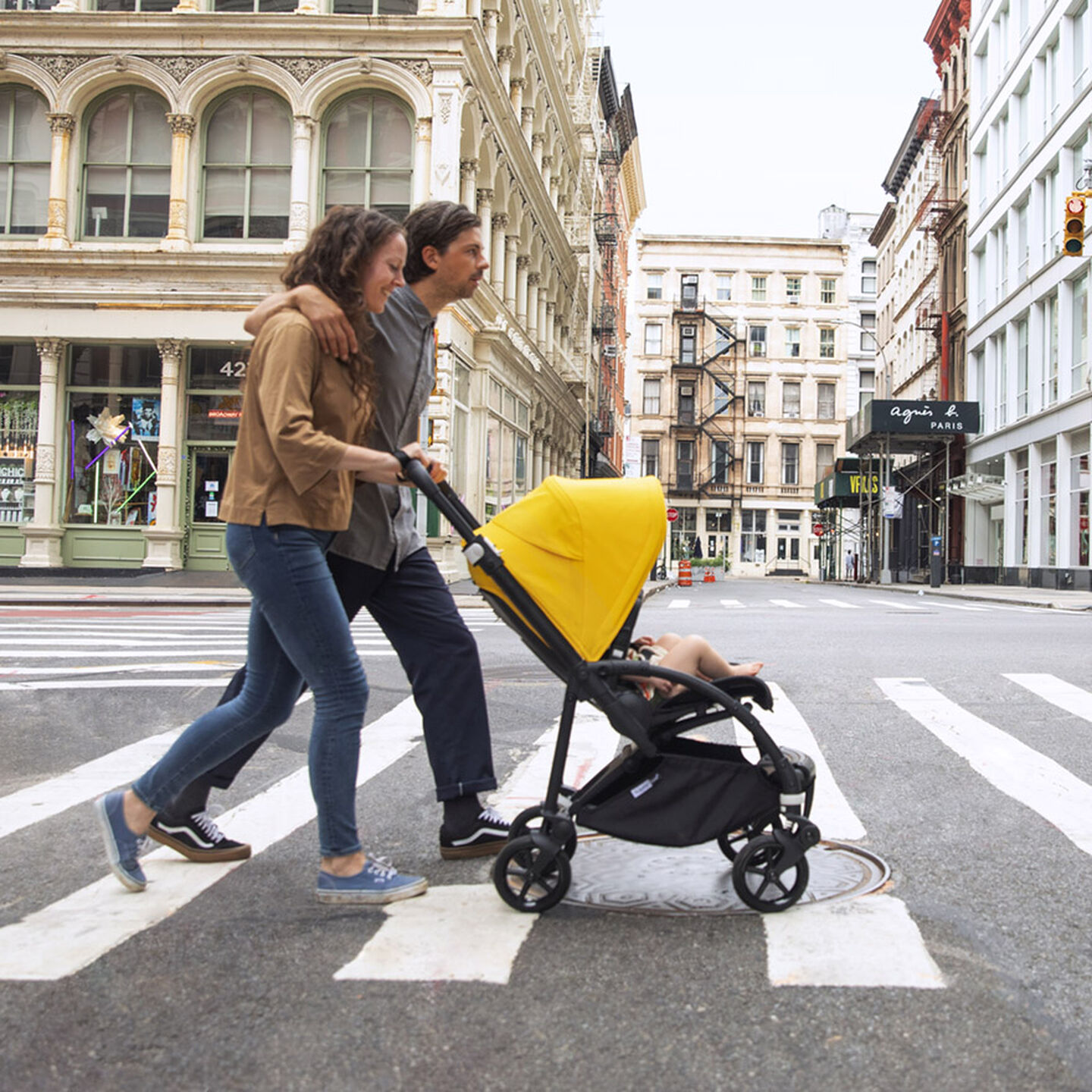 Couple pushing stroller on crosswalk