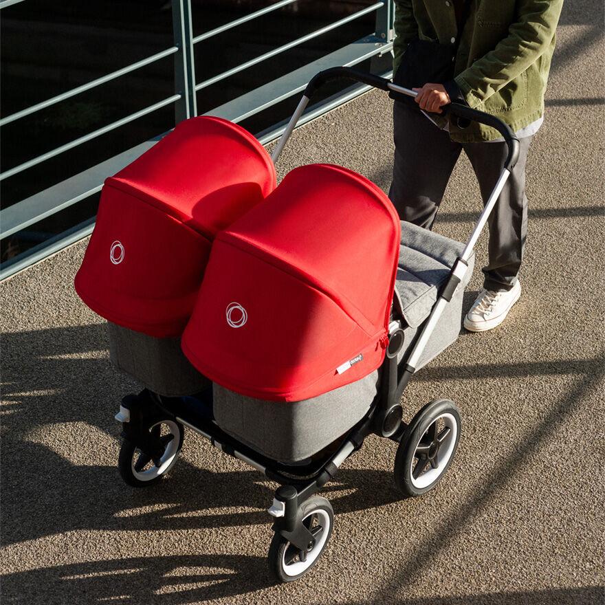 Man pushing twin stroller