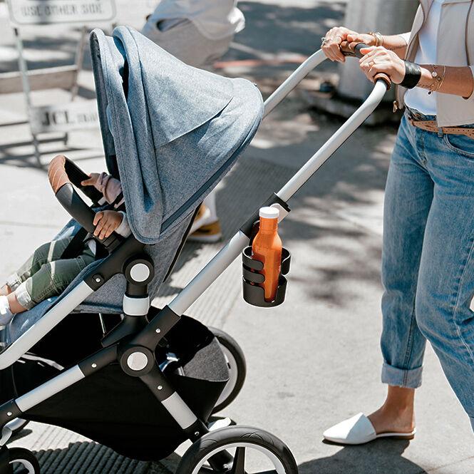 Woman pushing Lynx stroller