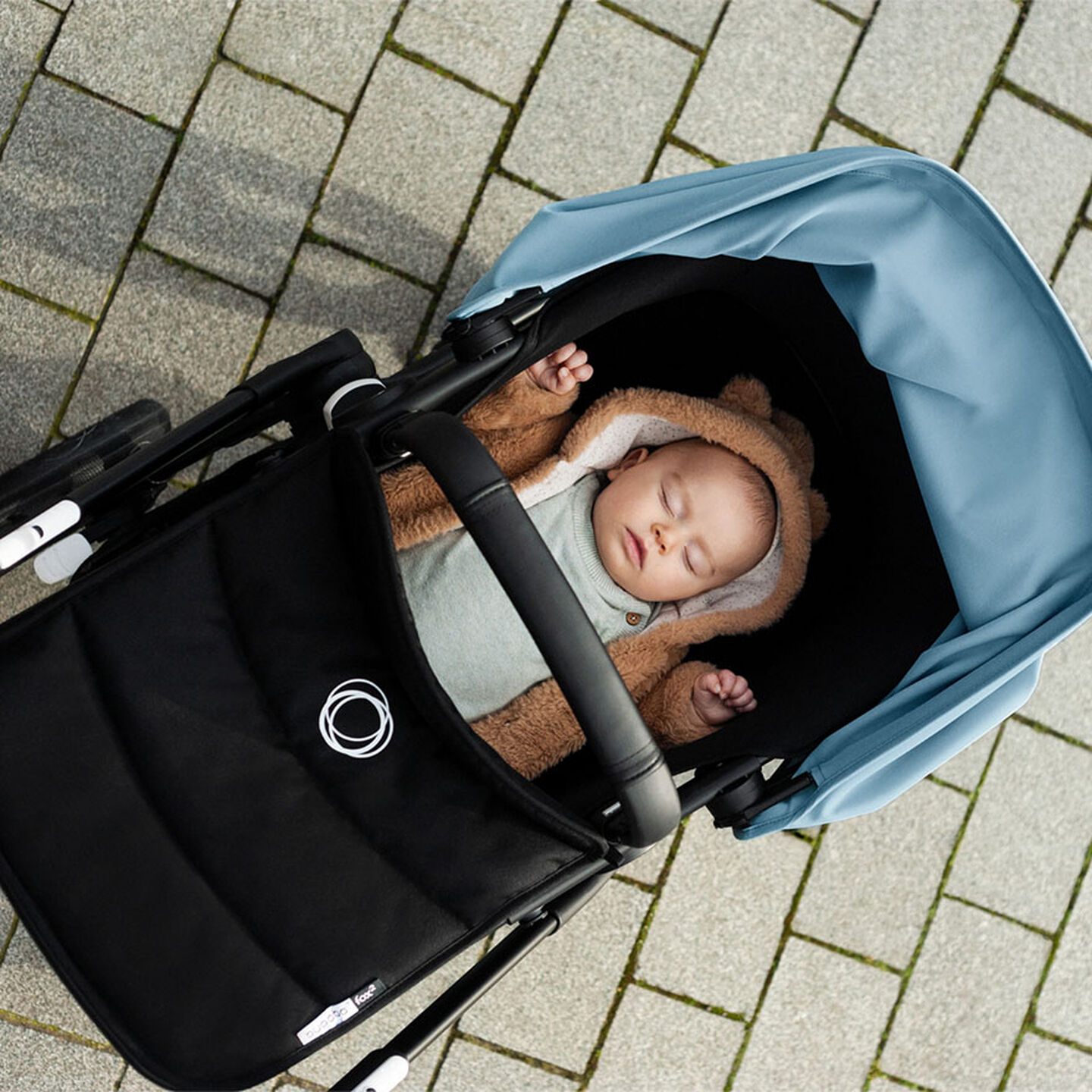 Baby napping in a stroller