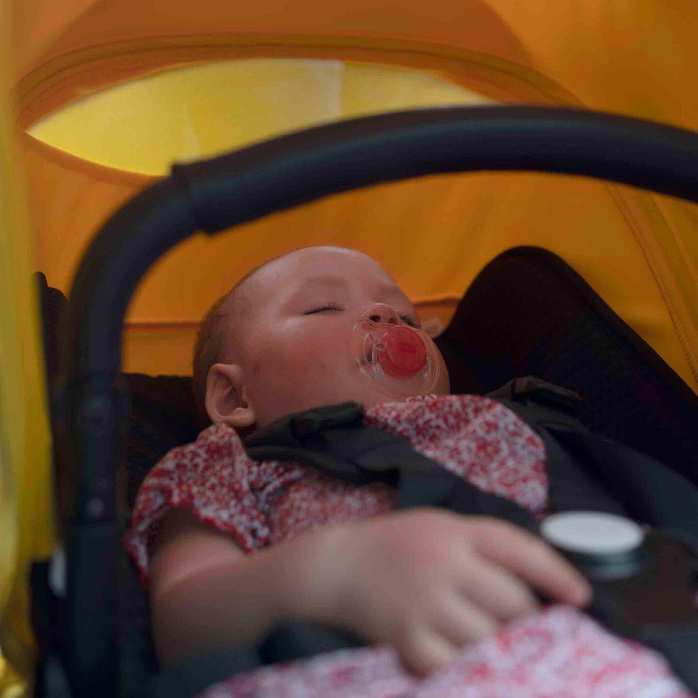 Baby asleep in stroller