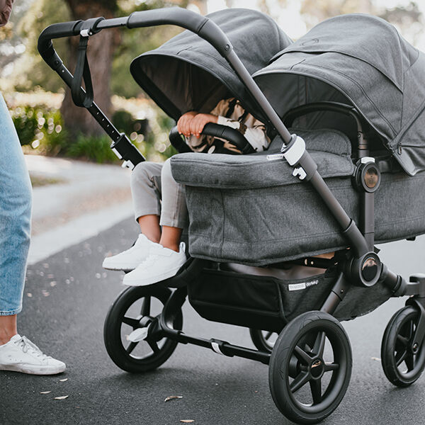 Toddler and baby in Donkey 3 Duo stroller